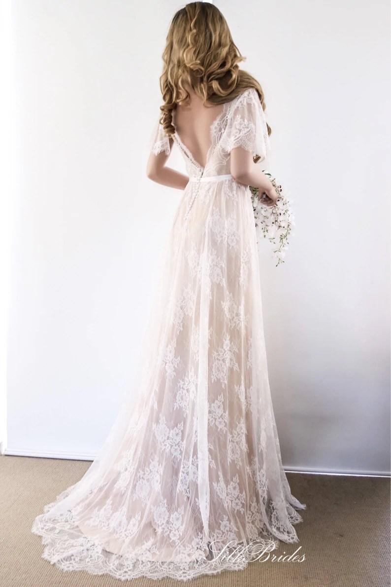 Satijnen jurk met kanten laag en open rug