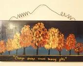 Change of season painting on wooden display