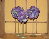 Set of hand made floral balls on brass stands