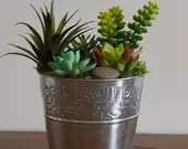 Artificial succulent arrangement in tin bucket