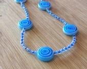 Blue Swirl Glass Beaded N...