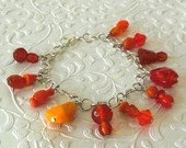 Orange Variety Glass Beaded Charm Bracelet