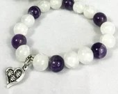 Amethyst stone bracelet and white pearl with heart charm. Jewelry, elastic bracelet