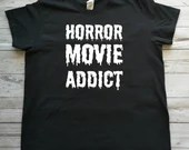 T-shirt with vinyl horror movie addict decal, halloween short sleeve sweaters.