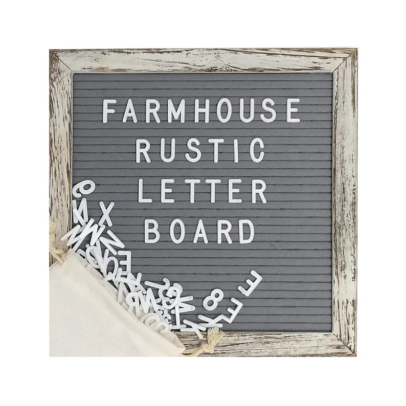 """Photo of board with letters spelling """"Farmhouse rustic letter board"""" with additional letters spilling out of a cloth beige bag in the bottom left corner."""