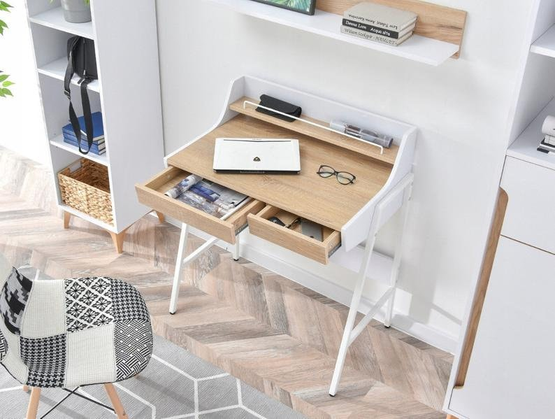 Photo of white home office ideas on etsy including a home office with mostly white decor. White and wood desk with drawers pulled out and common desk items. A black and white chair with wooden legs. White bookshelves with common office items on them. White shelf affixed to the wall with books and wooden backing. Grey and white rug.
