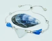 Silver sea glass bracelet with cobalt blue and sea foam sea glass on a sterling silver chain
