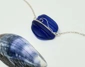 Cobalt blue sea glass necklace with a fine silver wire wave