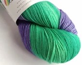 Self Striping sock yarn, hand dyed 75/25% superwash wool/nylon, fingering, 4-ply. Green and violet self-striping yarn.