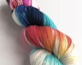 Hand dyed fine merino/mulberry silk 4ply/fingering weight yarn. Variegated space yarn with black, pink, blues, red, yellow and white.