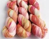 Hand dyed high twist superwash merino/nylon sock weight/fingering/4ply yarn. Ice dyed OOAK exclusive orange and pink variegated yarn.