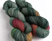 Indie dyed silver sparkle sock yarn, superwash merino/nylon/stellina sparkle sock yarn, hand dyed yarn.  Dark Winter Rainbow green/grey.
