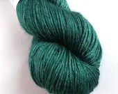 Hand dyed green yarn. 100g of baby camel/silk yarn DK, double knit yarn.  Semi-solid teal green yarn.