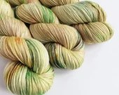 Hand dyed alpaca sock yarn,  superwash merino/superfine alpaca/nylon sock weight fingering 4ply yarn.  Lothlorien green gold beige speckles.