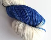 Hand dyed superwash merino dk wool yarn. Variegated double knit wool yarn, Blue Amanita wool yarn, blue and white with speckles.