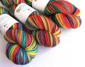 Hand dyed MCN sock yarn, superwash merino/cashmere/nylon 4ply/fingering wool yarn. Rainbow variegated red, orange, yellow, green, blue yarn.