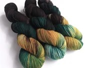 Hand dyed yarn, 100% superwash merino 4ply/fingering yarn. sock weight yarn, 4ply wool, Mutiny, black, brown, teal, gold hand painted yarn.