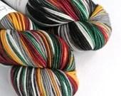 Hand dyed superwash merino dk wool yarn. Variegated double knit wool yarn, Strider, red, gold, green, grey, black, white, dk sw merino yarn