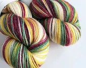 Hand dyed bamboo, 80/20% superwash merino/bamboo 4ply/fingering/sock weight yarn. Vintage Christmas, variegated gold, green, cream and reds.