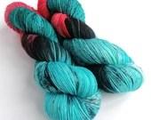 Hand dyed sock yarn, high twist superwash merino/nylon sock/fingering/4ply, variegated sock yarn, turquoise blue red black sock yarn, Astral