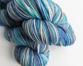 Hand dyed BFL aran yarn. Variegated blues and greys, indie dyed non superwash aran weight yarn. Suitable for cloth nappy covers.