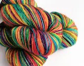 Hand dyed singles superwash merino/sparkle sock/4ply/fingering weight yarn. Variegated rainbow sparkly yarn.