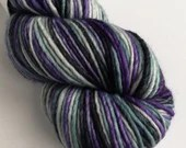 Hand dyed worsted weight singles merino wool yarn. Quirrell - variegated purple, grey and black wool yarn, non-superwash merino wool.