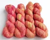 Hand dyed yarn, singles superwash merino 4ply wool yarn.  Rosy Maple Haze yellow, orange and deep pink, indie dyed tonal fingering weight.
