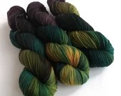Hand dyed organic merino 4ply/fingering yarn. Mutiny variegated wool yarn. Non superwash.  Black, gold, brown, teal for knitting, crochet.