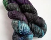 Hand dyed yarn, single ply merino/silk 4ply/fingering weight yarn. Variegated black, green, purple, blue, 1ply yarn, Bellatrix colourway.