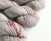 Hand dyed yarn, singles superwash merino 4ply wool yarn.  Dumbledore - silver grey with red and green speckles, indie dyed fingering weight.
