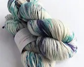 Hand dyed superwash merino worsted weight wool yarn. Variegated purple and blue yarn that has been ice and solar dyed. Rios worsted wool