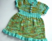 Hand knitted girl's d...