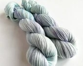 Hand dyed yarn. 50/50% sw merino/cotton 4ply/fingering weight yarn. Fleur, semi-solid pastel blues and purples, tonal wool and cotton yarn.