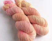 Indie dyed silver sparkle sock yarn, superwash merino/nylon/stellina sparkle sock yarn.  Summer's End peach orange and pink wool yarn.