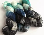 Hand dyed alpaca sock yarn,  superwash merino/superfine alpaca/nylon sock weight fingering 4ply yarn.  Enchanted Walk blues black white.