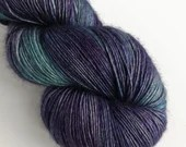 Hand dyed single ply superwash merino/yak/silk blend 4ply/fingering weight yarn.  Tonal blues on 4ply/fingering weight. Navy blue, purple.