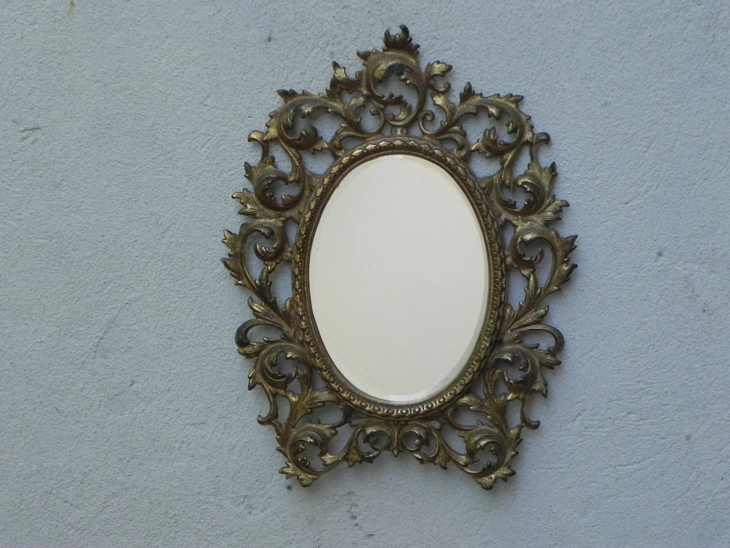 Small Gold Cast Metal Beveled Oval Wall Mirror