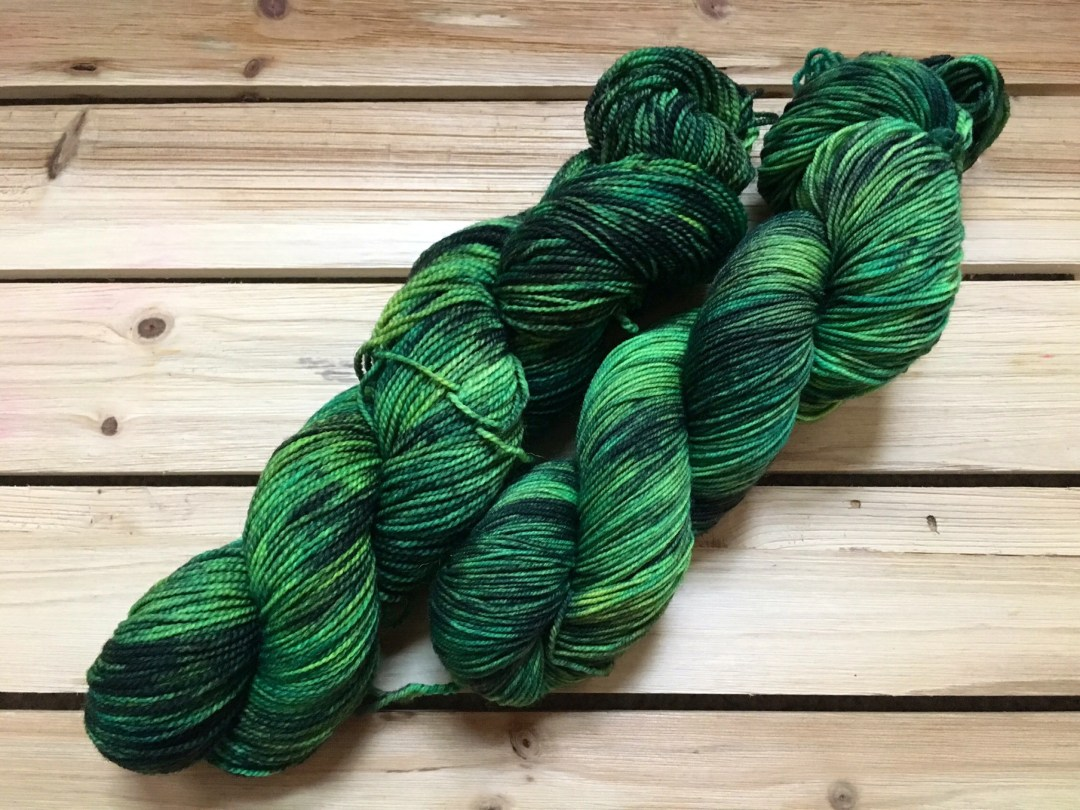 In Stock | Hand Dyed Yarn | Indie Dyed | Fingering Weight | Superwash Merino Wool | Speckled | Green | Black