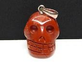 Red Jasper Carved Crystal Skull Pendant