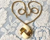 Vintage Signed Crown Trifari Gold & Ivory Square Knot Wreath Pendant Necklace with Gold Tone Chain 1950s 1960s
