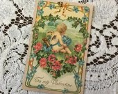 Antique Vintage 1905 To My Valentine Undivided Glittered Greetings Postcard 1900s Cupid Cherub in a Heart of Pink Roses Blue Flowers Meadow