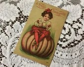 Antique Vintage c1908 Color Postcard Post Card A HAPPY THANKSGIVING Greetings 1900s Cute Little Girl Sitting on a Giant Pumpkin Fall Colors