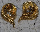 Vintage Gold Tone Feather Curled Around Rhinestone Earrings