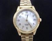 Working Retro Timex Indiglo Ladies Goldtone watch - stretch band
