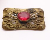 Antique Brooch with Ruby Red Rhinestone on Gold Tone Setting - ca 1910