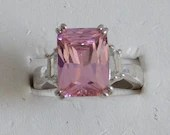 Pink Faceted Rhinestone Ring with Clear Rhinestone Baguette Accent on a Silver Tone Setting Size 9
