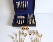 International Gold 71 Pc Service for 8 Set with 5 Pc Place Setting 8 Napkin Rings 8 Salt & Pepper Sets 5 Serving Pcs and 2 Candlesticks