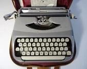 Vintage 1960 Royal Royalite Portable Typewriter with Case and Manual.