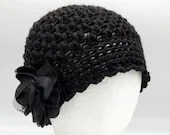 Black 1920s Cloche w/silver glitter strands and beaded flower hat pin